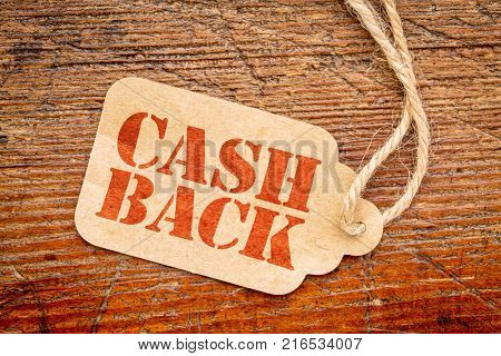 cash back sign - red stencil text on a cardboard price tag against rustic wood