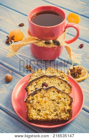 Fresh Baked Fruitcake With Ingredients On White Boards