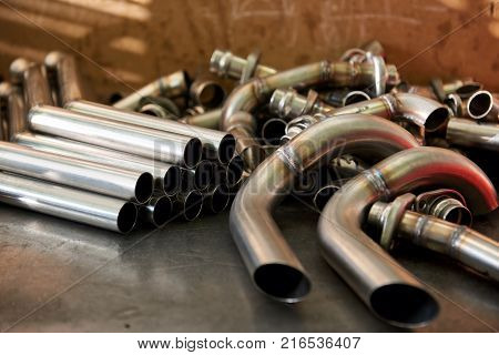 Pile of steel pipes. Straight and bent pipes.