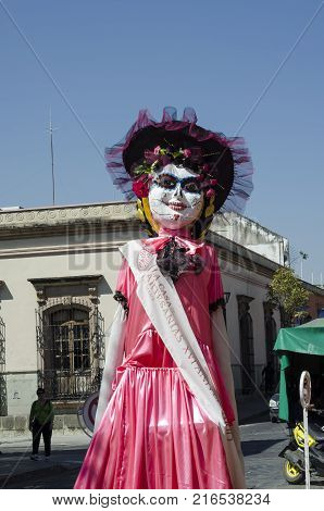 OAXACA, OAXACA, MEXICO- NOVEMBER 1, 2017: Giant puppet skull dressed as catrina as decoration for mexican Day of the Dead in Oaxaca, Mexico