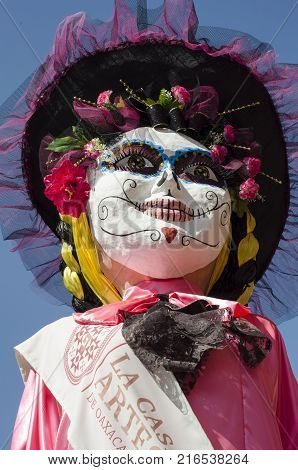 OAXACA, OAXACA, MEXICO- NOVEMBER 1, 2017: Giant puppet dressed as a catrina as decoration for mexican Day of the Dead in Oaxaca, Mexico
