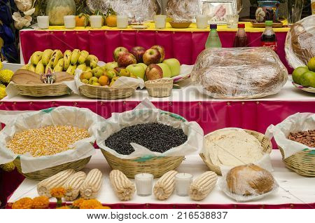 OAXACA, OAXACA, MEXICO- NOVEMBER 1, 2017: Traditional mexican Day of the Dead offering altar with fruits,bread,seeds, drinks and corn in Oaxaca, Mexico