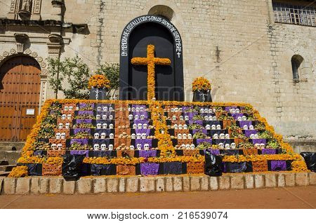OAXACA, OAXACA, MEXICO- NOVEMBER 1, 2017: Traditional Day of the Dead offering altar in Oaxaca, Mexico for the victims of the earthquakes of September 2017
