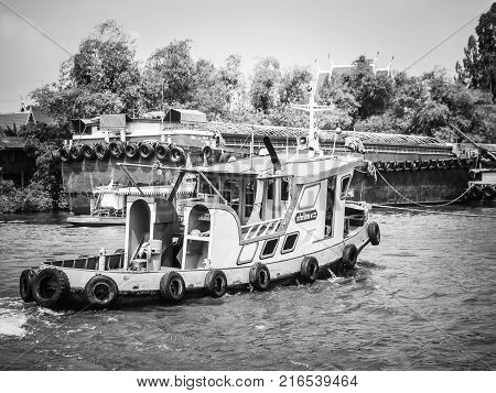 Loaded Tug Boat With Barge On Chaopraya River For Cargo Transportation Taken In Bangkok Thailand On
