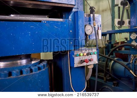 Hydraulic press machine, control panel. Equipment at the factory. Hydraulic system example.