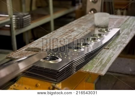 Aircraft parts on workshop desk. Steel panels, airplane fuselage.