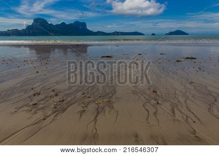 view of beachside with island on background and cloudy sky in lio beach in philippines, El nido