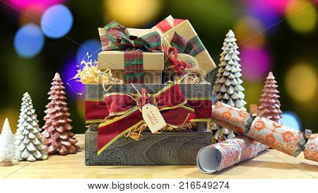 Large English style traditional Christmas hamper with paper wrapped gifts and food. static against bokeh lights of Christmas Tree.