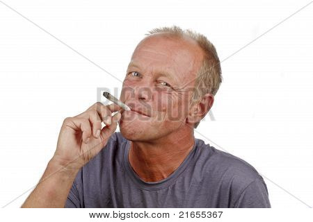 Man enjoying smoking s marihuana joint