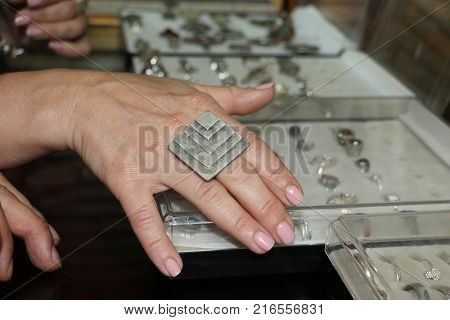 Woman Trying Rings At A Jeweller Shop
