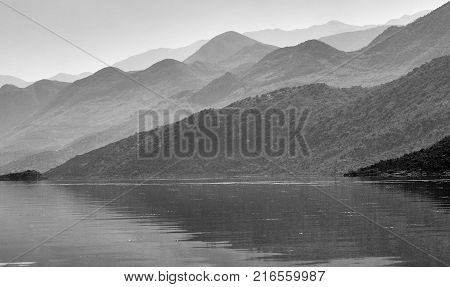 Misty hills over the water, lake Skadar in Montenegro