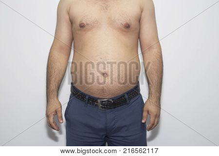 man with overweight. symbolic photo for beer belly, unsuccessful dieting and eating the wrong foods. Weight loss concept.