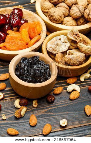 natural organic dried fruits and nuts on wooden background