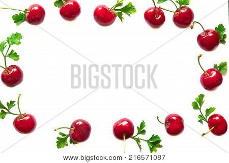 Fresh cherries on white isolated background in top view flat lay with copy space. Cherry frame can use for web cover or banner. Cherry have high vitamin C and have sweet and sour taste. Red cherry is healthy fruit. Cherry background concept.