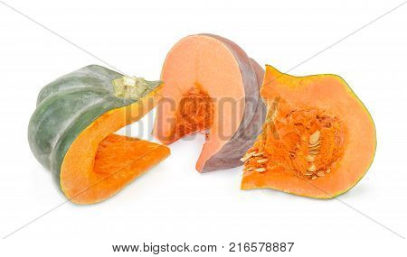 Piece of the orange pumpkin piece of winter squash with dark green rind and piece of pumpkin with pulp and pumpkin seeds on a white background