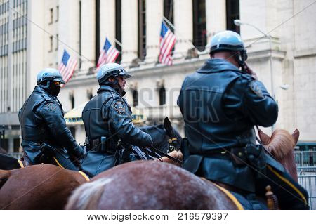 New York City, USA - Nov 12, 2011 : Three policemen on horses in front of the New York Stock Exchange building