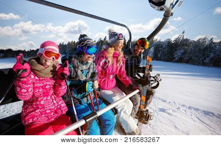 Skiing, ski lift, winter - skiers on ski lift at snow mountain