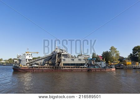 Belozersk, Vologda region, Russia - August 10, 2015: Vessel SH-402, designed for carrying out dredging works on White Lake near the town of Belozersk in the Vologda region