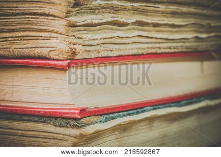 Ancient books. A bunch of old books. Books in the old cover close up