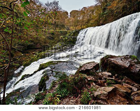 Sgwd Isaf Clun-gwynor or Lower Fall of the White Meadow is one of the four main waterfalls