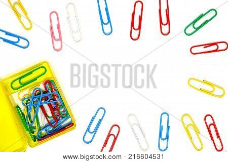 Frame of multicolour of paperclips on white background, office and school stationary object