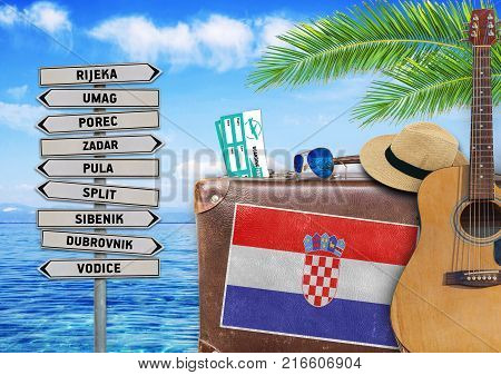 Concept of summer traveling with old suitcase and Croatia