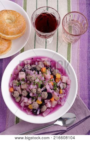 Purple carrot soup with meatballs and red wine