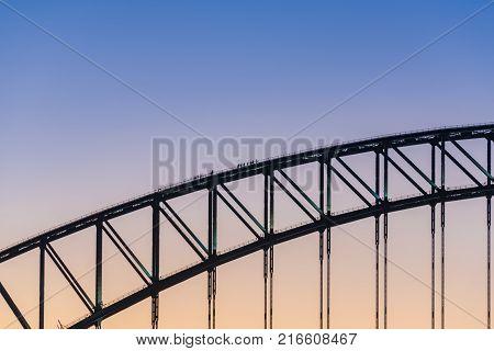 Sydney Harbour Bridge at blue hour against purple blue sky on the background. Sydney Australia