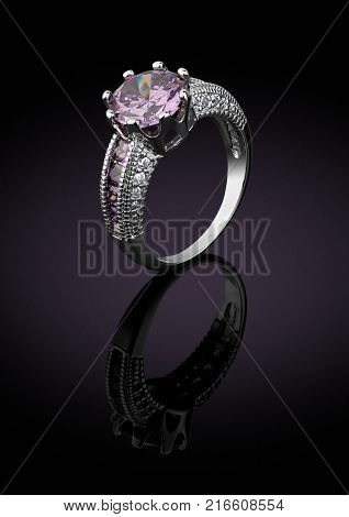 Jewelry ring with gemstone on black background