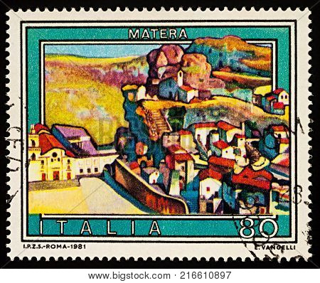 Moscow Russia - December 03 2017: A stamp printed in Italy shows picture of Matera - ancient city in Southern Italy series