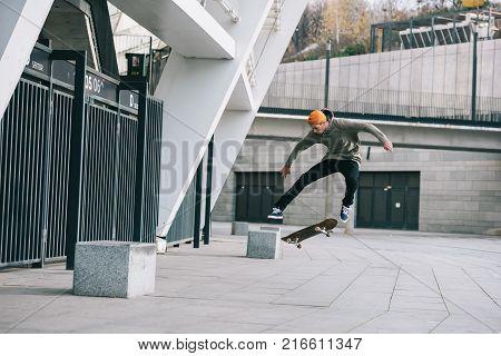 skateboarder performing jump trick in urban location