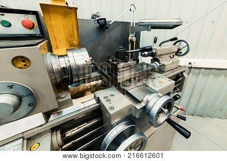 Modern lathe-cutting machine with manual control. Metalworking equipment.