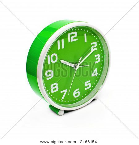 Green plastic alarm clock on the white background poster