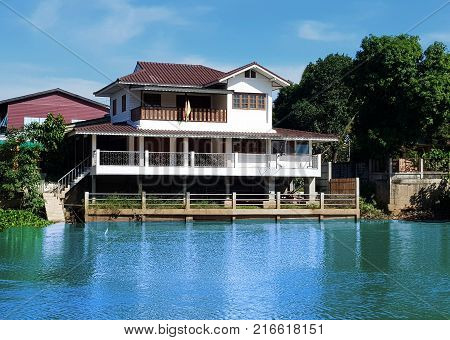 House with beautiful landscape and lakeCity landscape the upper lake with beautiful houses.