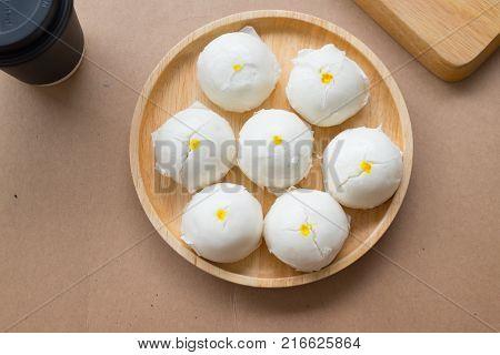 Steamed creamy custard bun on wooden dish