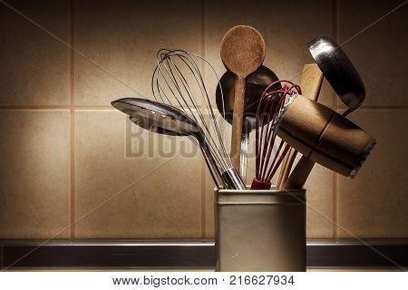 Various kitchen utensils for preparing food closeup view.