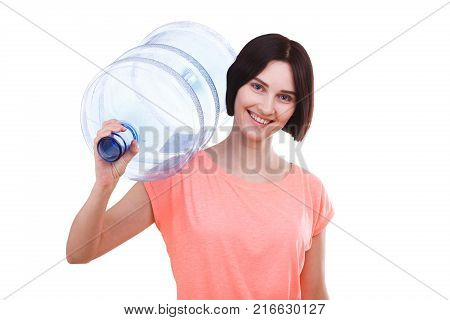 Beautiful brunette girl with a smile in a pink t-shirt holds a bottle on the shoulder for a cooler on a white isolated background