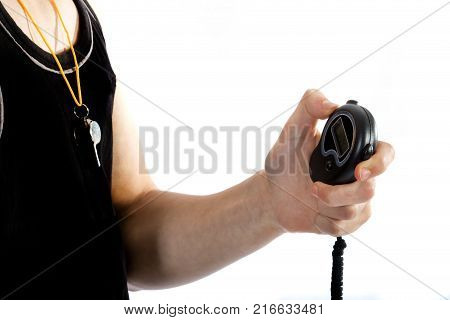 Teenage personal trainer holding a stop watch isolated on a white background