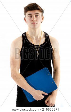 Teenage personal trainer holding a clipboard isolated on a white background