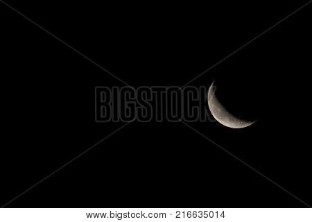 Waning crescent Moon with room on left of image for text or copy.