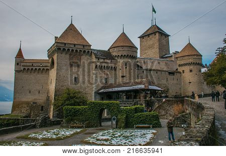 MONTREUX, SWITZERLAND - DECEMBER 2, 2017: View of Chillon Castle, Switzerland. Montreaux, Lake Geneve, one of the most vi