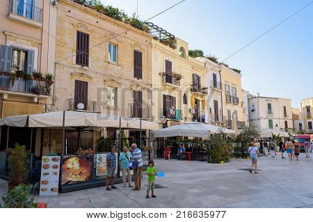 Bari Italy - September 02 2016: Tourists visit Piazza Mercantile in the center of Bari with menay shops and restaurants.