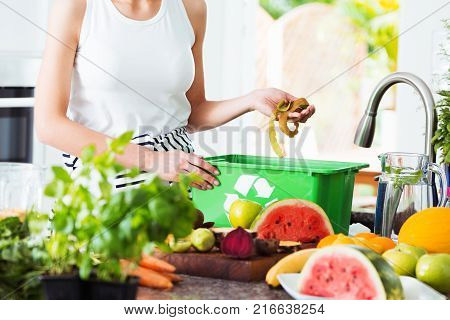 Woman Disposing Leftover Of Fruits