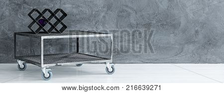 Industrial Table Against Concrete Wall