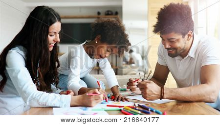 Happy family drawing and spending time together at home
