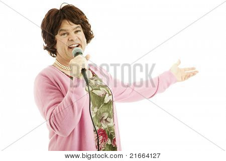 Male cross dresser impersonates a middle-aged female singer.  Isolated on white.