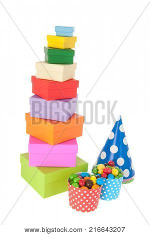 Stack birthday gifts and candy with party hats