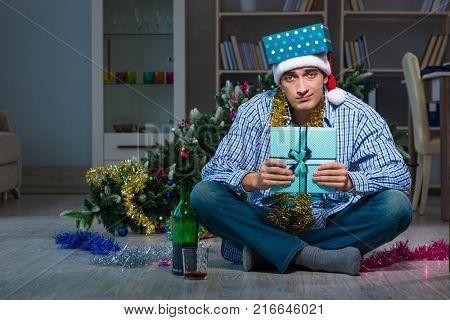 Man celebrating christmas at home alone
