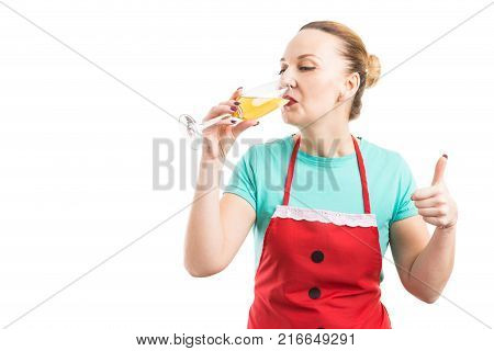 Housewife Wearing Red Apron And Drinking Champagne