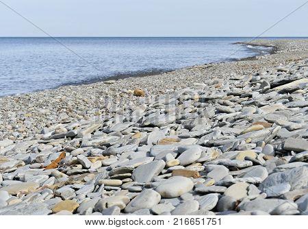 Rocky Shoreline Beside A Lake